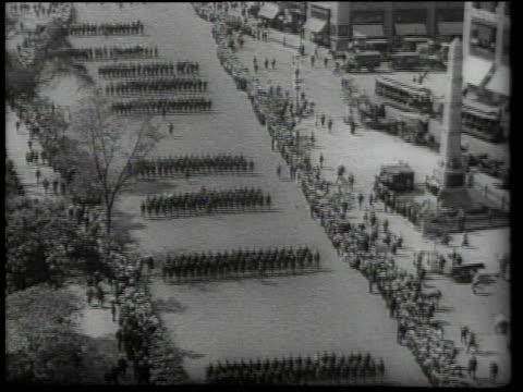 Soldiers and civilians marching in WWI parade / United States