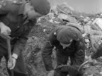 Soldiers and volunteers fill sandbags to act as sea defences at SuttononSea following the terrible flooding 1953