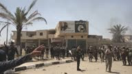 Soldiers celebrate after Iraqi security forces and supporting militias have retaken the key town of Karma from Daesh as part of a push to recapture...