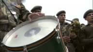 Soldiers drumming and playing pipes, Kedarnath, India Available in HD.