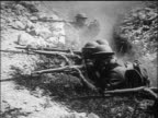 B/W 1917/18 soldiers in trenches with gas masks helmets firing rifles / World War I / newsreel