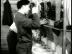 Soldiers lounging in new barracks MS Combing hair in wash room MS Writing letter HA WS Soldiers eating in mess hall CU Food on tray MS Corporal...