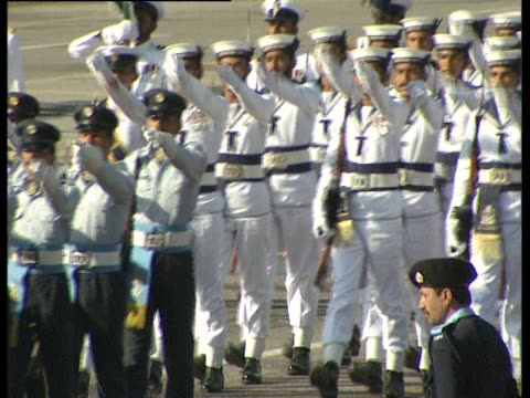 Soldiers march during the National Day parade in Islamabad