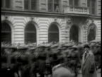 S Soldiers marching down street civilians BG MS Boston policemen leaving building Governor Calvin Coolidge shaking hands w/ uniformed officer WS...