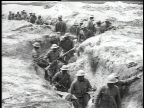 WWI soldiers marching through trenches