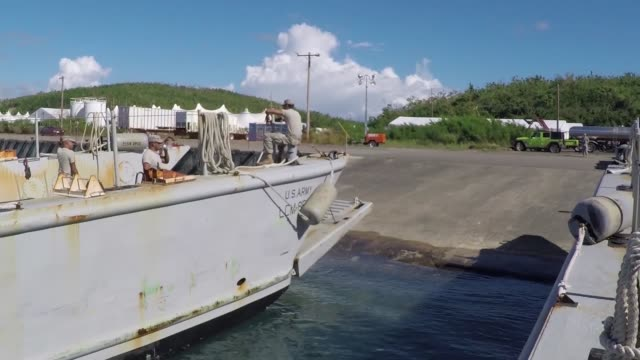 Soldiers of the Puerto Rico National Guard and the Ohio National Guard work together to bring food and water to Vieques