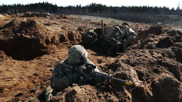 Soldiers of US Army Chaos Company 168 Armor Battalion of the 3rd Brigade Combat Team 4th Infantry Division overrun an enemy position during a joint...