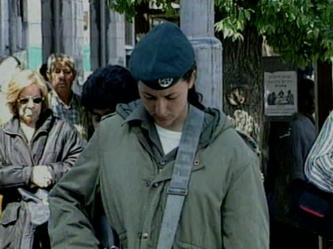 Soldiers on the streets of Jerusalem stop and observe a two mintue silence to mark Holocaust Day 1998