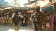 DS Soldiers patrolling a busy market in Yarmouk / Baghdad Iraq