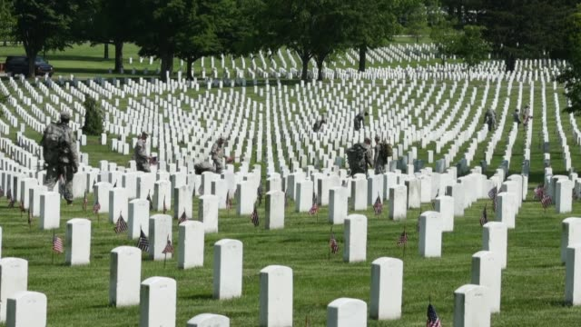 ELS soldiers place flags at gravestones ahead of the 150th Arlington Cemetery anniversary As part of Arlington National Cemetery 150th anniversary...