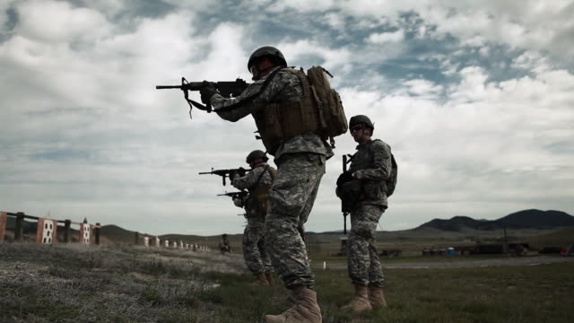 Soldiers practicing firing weapons at range