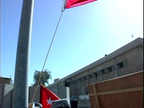 Soldiers raising Third Infantry Division flag and commemorative flag during 911 ceremony at Camp Victory / Baghdad Iraq / AUDIO