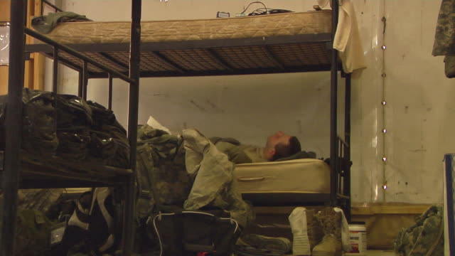 MS Soldiers relaxing on bunkbed / Musa Qala Helmand Province Afghanistan