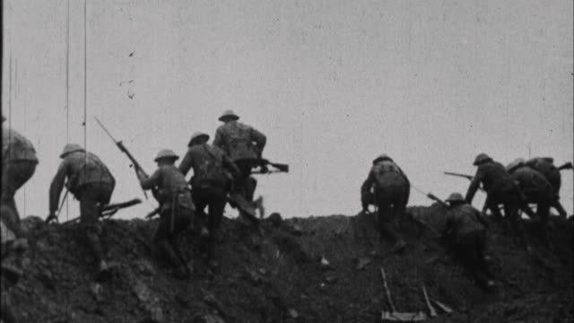 Soldiers running away from trench / France