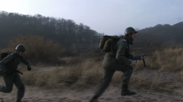 soldiers running on the beach steadycam shot