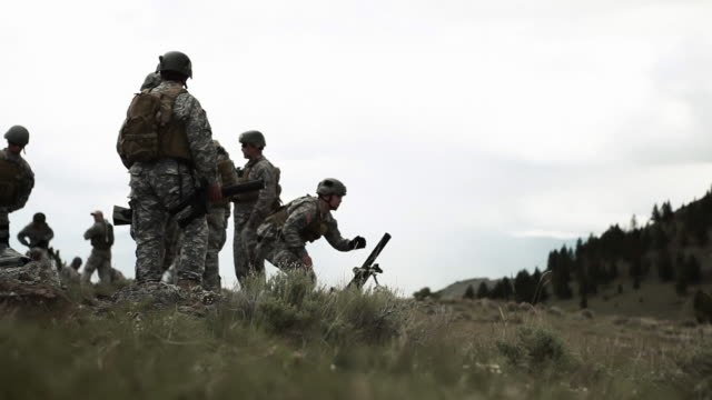 Soldiers setting up on mortar range for training and practice.