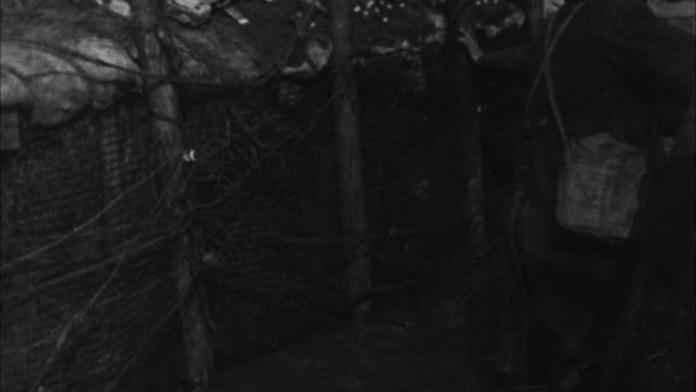 Soldiers wait in trenches / France