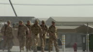 WS Soldiers walking on road armored vehicle in background / Musa Qala Helmand Province Afghanistan