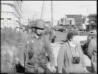 US soldiers walking past senior couple on sidewalk / Berlin Germany / newsreel