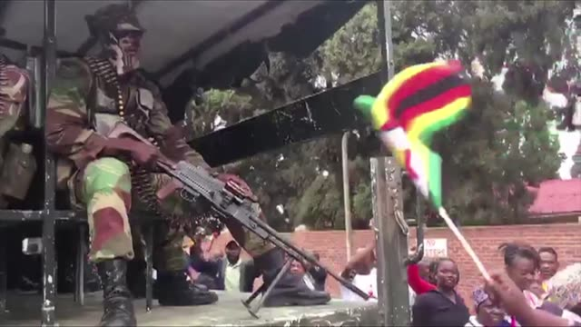 Soldiers whippedup crowds of anti Mugabe marchers into a frenzy of cheering and dancing in downtown Harare flanked by the tanks and armoured...