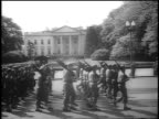 B/W 1945 soldiers with rifles march in front of White House at FDR's funeral procession / Washington