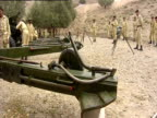 Soldiers work with large guns
