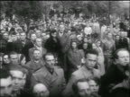 PAN solemn faces of crowd gathered for funeral / Hungarian uprising