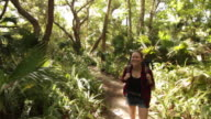 Solo Female Backpacker Exploring a Forest