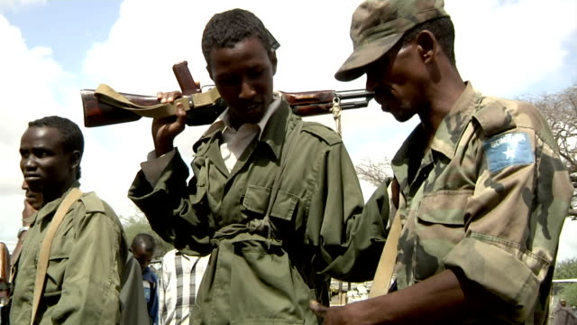 Somali militia men talking on July 31 2011 in Dhoobley Somalia
