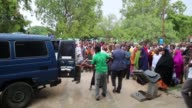 Somalians are taken to the hospital after they got injured in a car bomb attack and gunfire claimed by AlQaedaaffiliated Shabaab militants which...