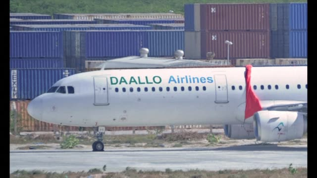 Somalis government denies that a blast that ripped a hole in a commercial airliner shortly after take off from Mogadishu was caused by a bomb