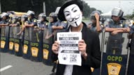Some 100 masked members of the hacking group Anonymous Philippines marched on parliament Tuesday denouncing corruption and pledging more cyber...