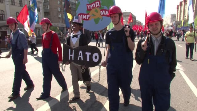 Some 100000 workers joined a May Day parade on Moscows Red Square Thursday for the first time since the 1991 Soviet breakup as the takeover of Crimea...