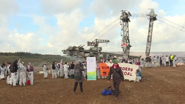 Some 200 demonstrators denounce the impact of coal on the climate at a mine near Bonn where the 23rd UN conference on climate change is due to open...