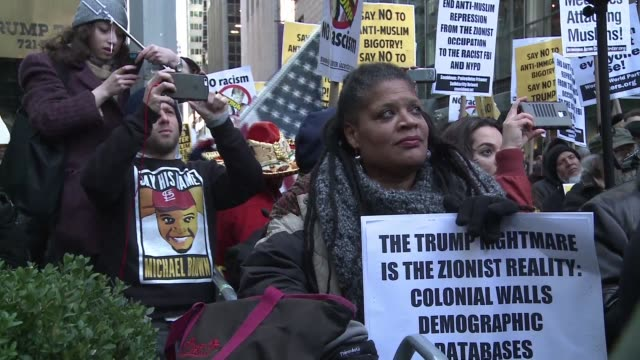 Some 200 protesters gathered Sunday at Donald Trumps New York City headquarters accusing presidential hopeful of fascism and racism following his...