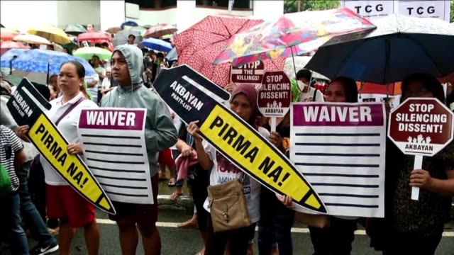 Some 3000 people participate in a rain soaked street protest in Manila where they are calling on Duterte to stop the killings and to disclose what an...