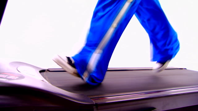 Someone jumps on a treadmill that is already running