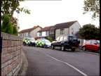 Three found shot dead in village ITN ENGLAND Somerset Horton Police vehicles parked outside house where bodies of a man woman and child were found...
