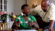 Son Shows Father his Science Project of a Molecule