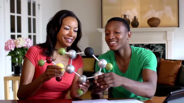 Son Shows Mother his Science Project of a Molecule
