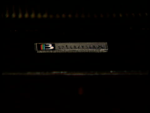 Sony Betamax cassette tape is put into videotape recorder and close shots of Betamax VCR controls Betamax videotape recorder machine on September 11...