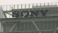 Sony says its fiscal first half net profit dives owing to a sharp rally in the yen and losses linked to the sale of its battery business