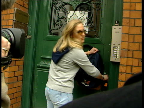 Sophie Countess of Wessex controversy C4N ALEX London Mayfair Woman employee of Sophie Rhys Jones' PR company sorting bag as arriving at work CS 'RJH...