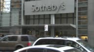 Sothebys exteriors and signage in New York NY on December 8 Traffic and people passing the Sothebys entrance