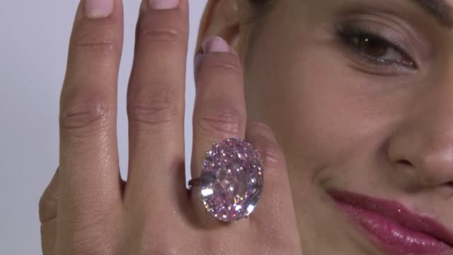 Sothebys on Wednesday showed off a 596 carat pink diamond that will be auctioned in the Swiss city of Geneva in November at a record asking price of...