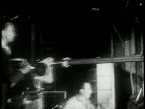 1951 MS sound crew operating a large boom microphone and recording audio on a sound stage
