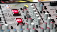 sound mixer pushing buttons close-up. Mixing desks, audio production consoles, soundboards, electronic graphic equalizer, audio sound mastering.