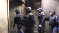 South Afican police and soldiers raid a hostel in a Johannesburg township following the governements decision to deploy soldiers to tackle gangs...