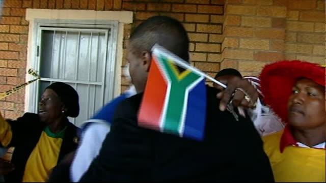 South African captain Aaron Mokoena interview SOUTH AFRICA Gauteng Boipatong EXT Various of Aaron Mokoena hugging people as returns to his home...