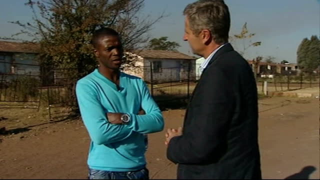 South African captain Aaron Mokoena interview Aaron Mokoena interview with reporter in shot SOT On poverty in local area / this world cup is...